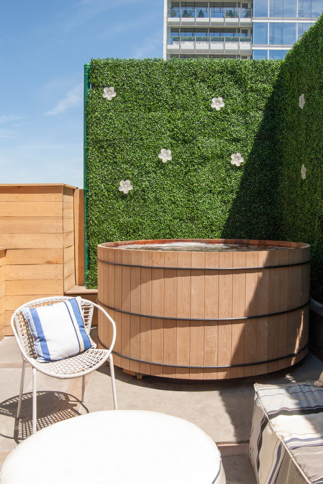 a living wall is a great privacy screen for an outdoor hottub