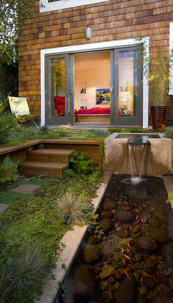 a contemporary patio with a koi pond and a little waterfall - Koi Pond Designs Ideas