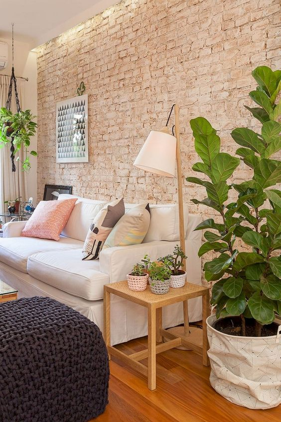 a cozy living room with a muted brick wall that is textural yet rather soft-looking