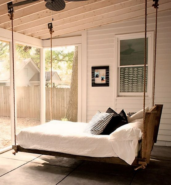 a hanging bed of wood and rope, with neutral bedding and printed pillows will let you relax a bit