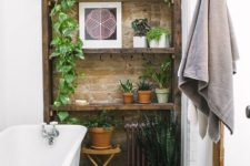 a touch of brick and potted greenery make the bathroom really eye-catching and really cool