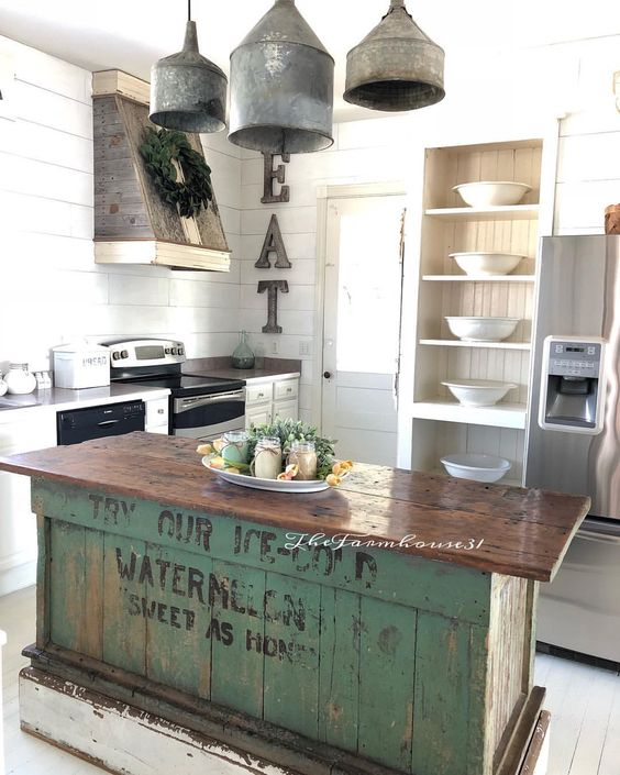 a vintage industrial kitchen island of wood with a green base of crates that looks very eye-catchy