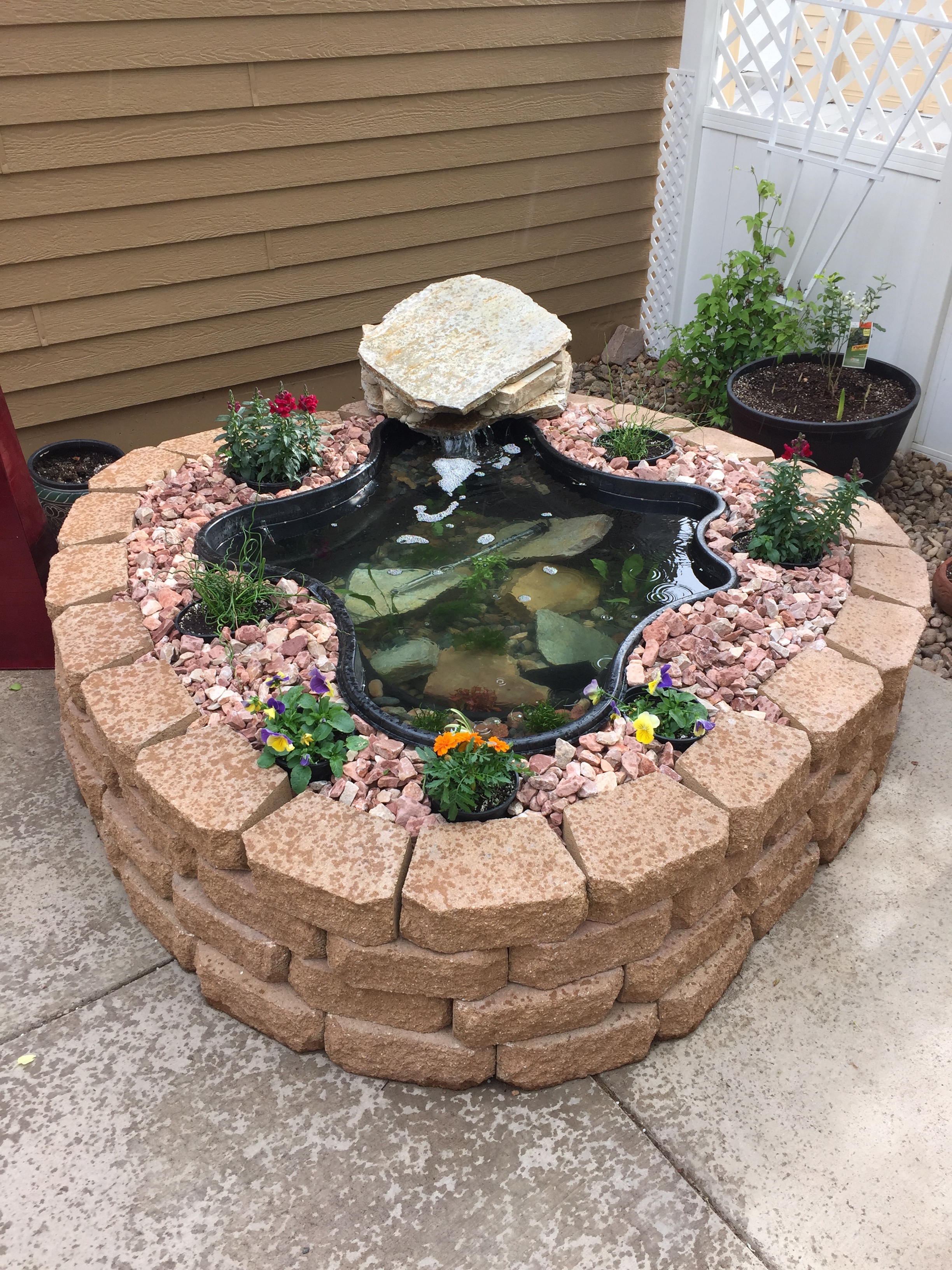 67 cool backyard pond design ideas digsdigs for Easy fish pond