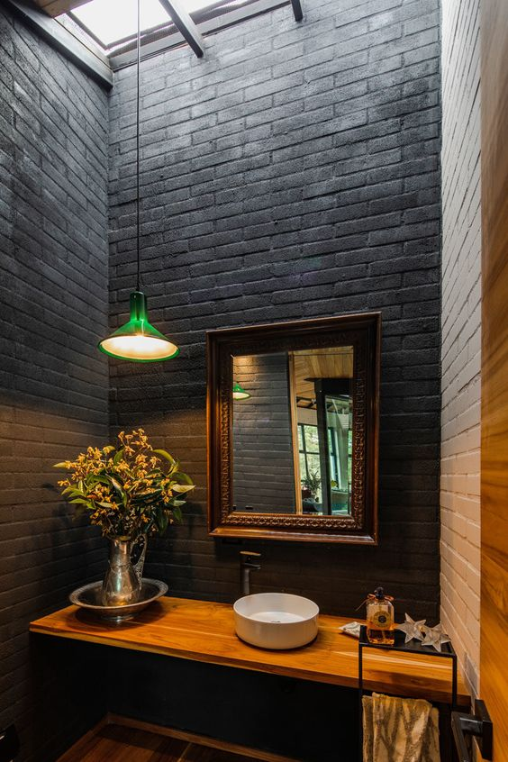 black and white bricks, a light colored floating vanity and a mirror in a refined frame is a very cool and chic idea