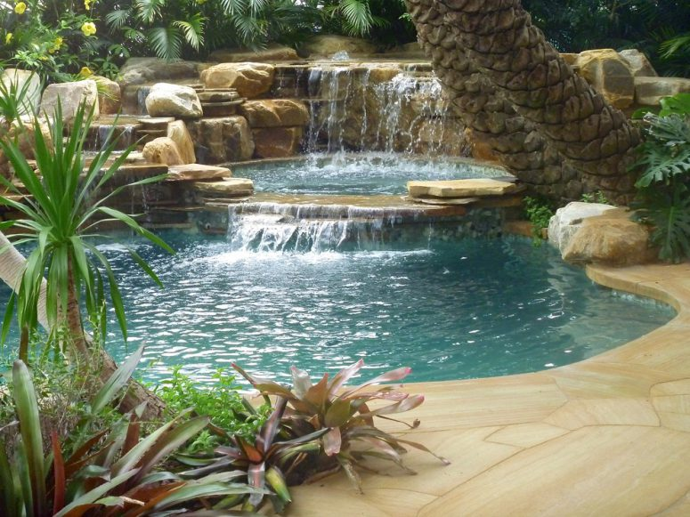 even a tropical pool would become more amazing if you add a waterfall to it - Waterfall Landscape Design Ideas