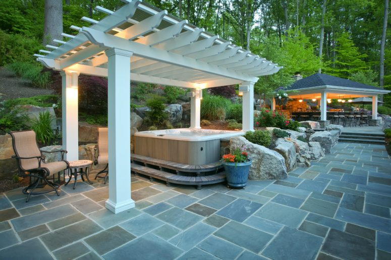 fiberglass pergola could protect your tub so you can enjoy it even during a rain  (Fine Decks Inc.)