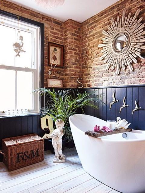 red brick and navy paneling walls create a bold and contrasting combo that makes the space chic