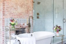 red brick highlights the fireplace and makes the bathroom look very vintage-like and very refined