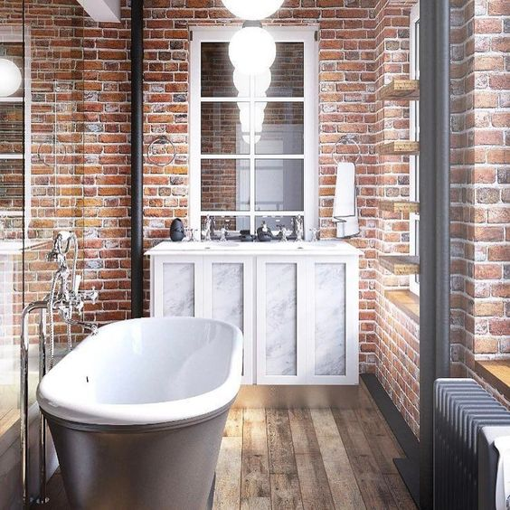 red brick walls and a wooden floor make an amazing combo, and a vintage tub and vanity add chic