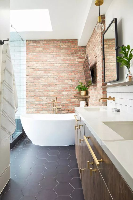red bricks highlight the bathtub space making it stand out in white and navy bathroom and look bolder