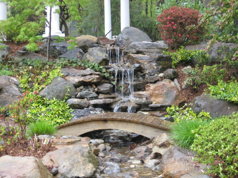 Waterfall Landscape Design Ideas landscaping waterfalls Rustic Backyard With An Amazing Waterfall And A Cute Little Wooden Bridge