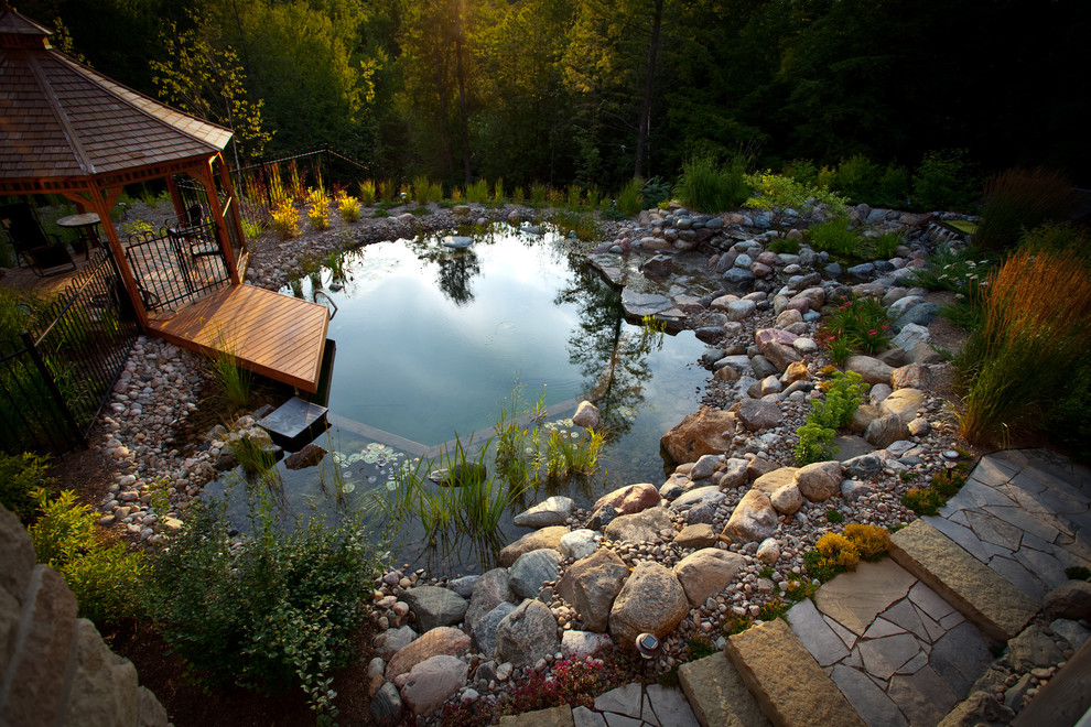 stone pavers could surround any swimming pond so you could walk by it
