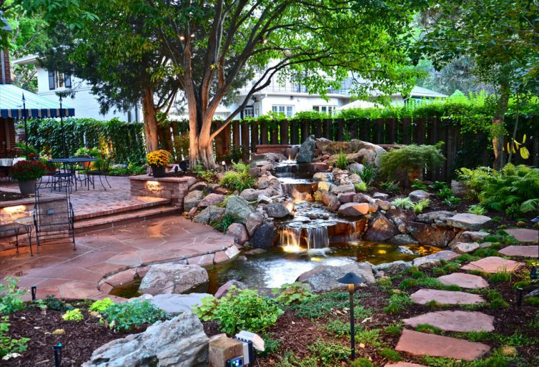 stone pavers is the best way to cover the area around stone waterfall - 75 Relaxing Garden And Backyard Waterfalls - DigsDigs