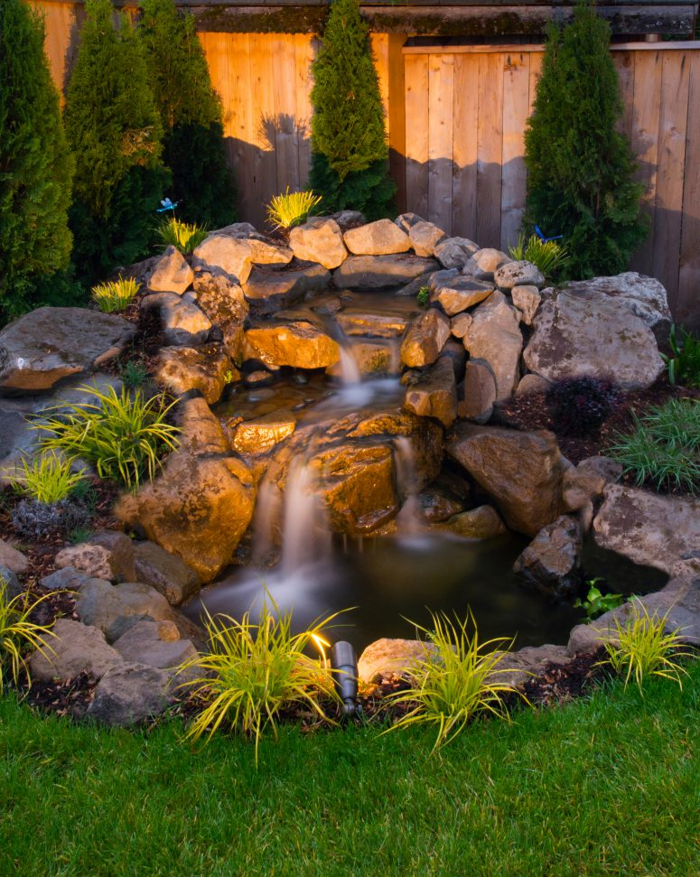 75 relaxing garden and backyard waterfalls digsdigs for Waterfall garden feature