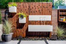 this is a very interesting solution to upgrade your fence with planters and waterfalls