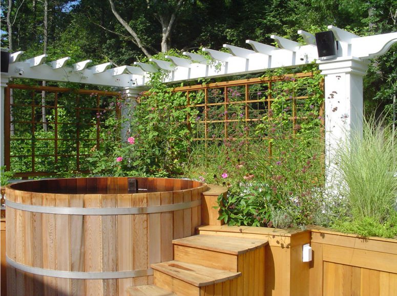 trellises on two sides of this wooden hot tub could help to create a flowering privacy screen