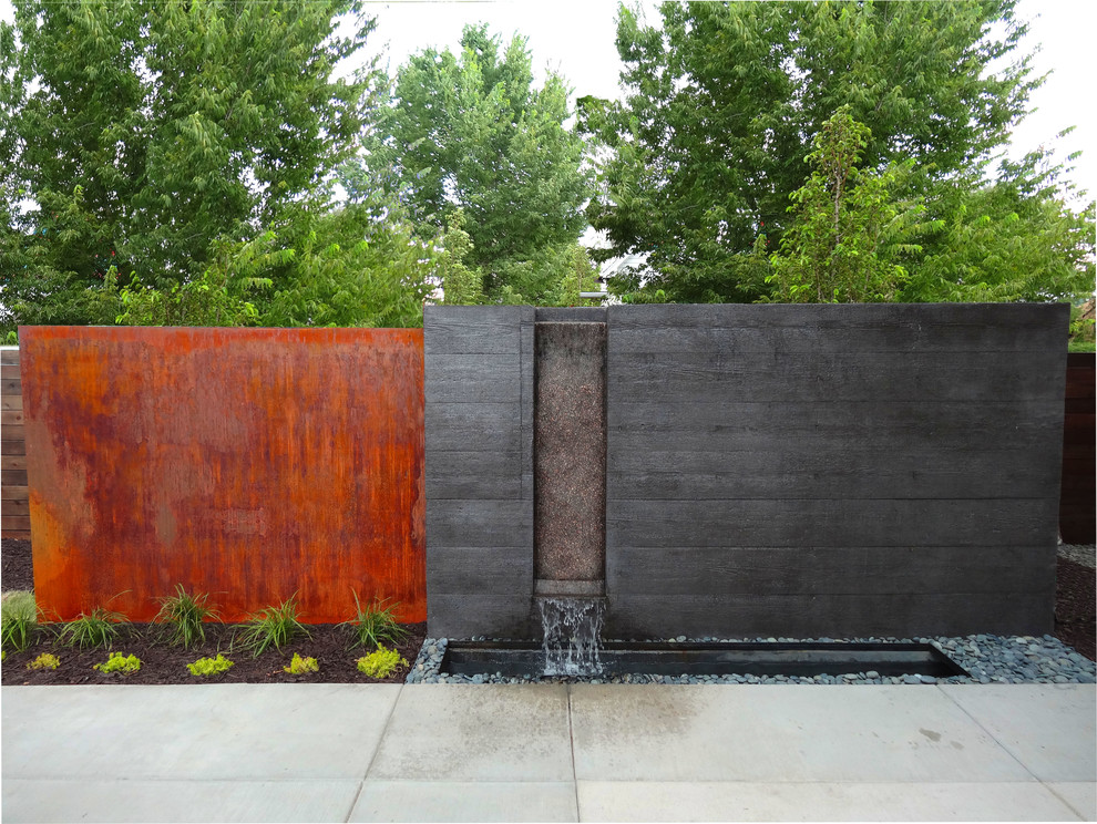 49 amazing outdoor water walls for your backyard digsdigs for Waterfall water feature