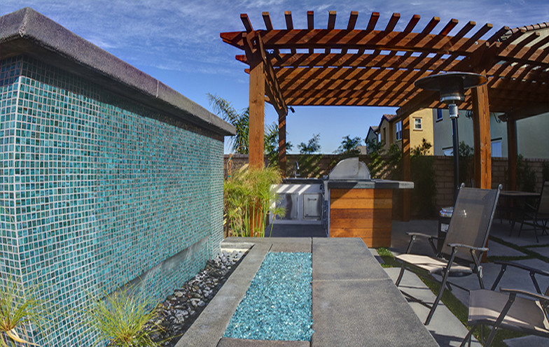 Mosaic tiles work for water walls as good as for pools.