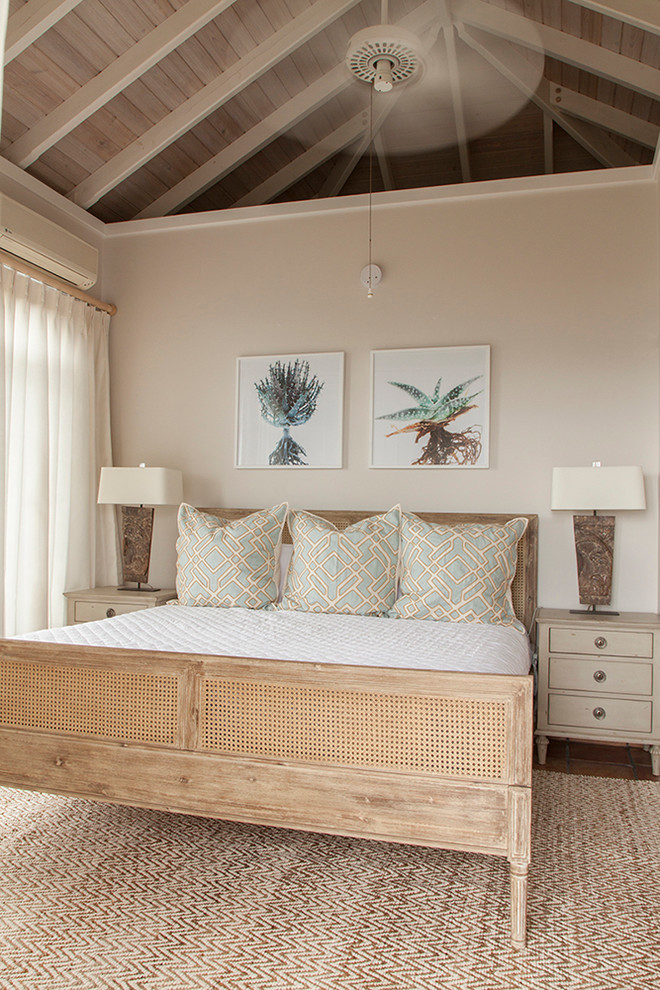 an all-neutral tropical bedroom done with textures - wicker, cane, wood, jute and a couple of tropical artworks  (Mimi & Hill interiors)