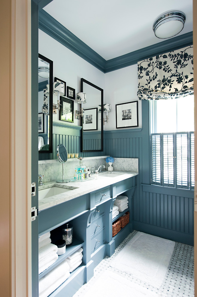 a blue and white farmhouse bathroom features a shade of blue inspired by the ocean  (ColeBuilt)