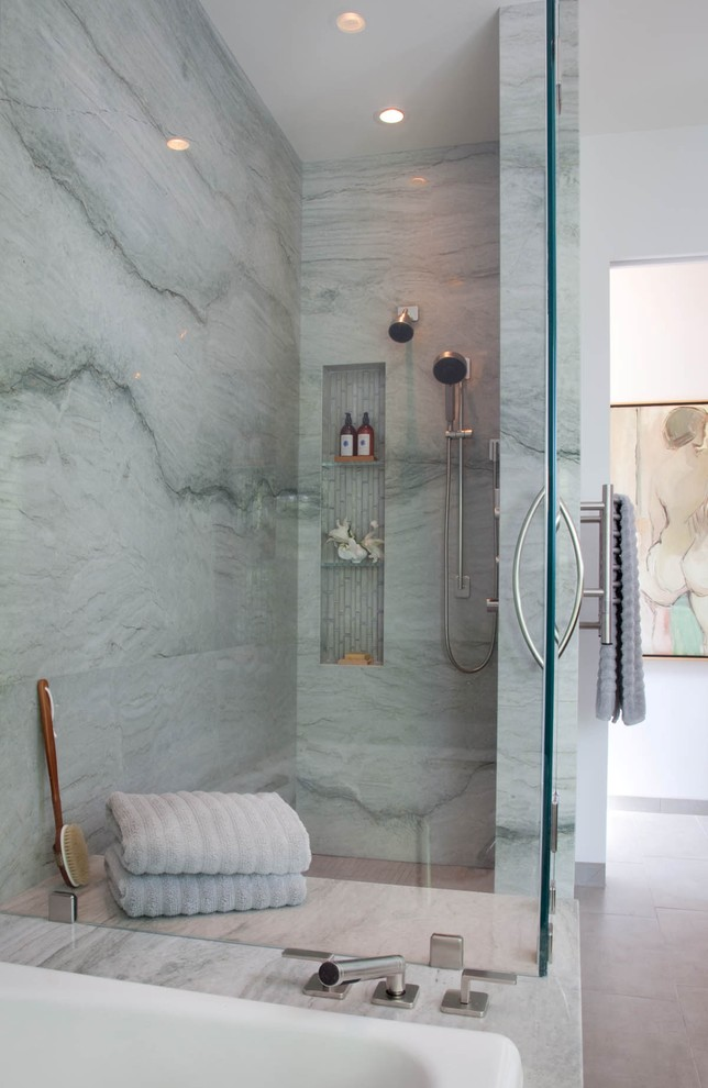 a blue stone shower space with a niche for storage, blue towels and touches of wood  (Reveal Studio)