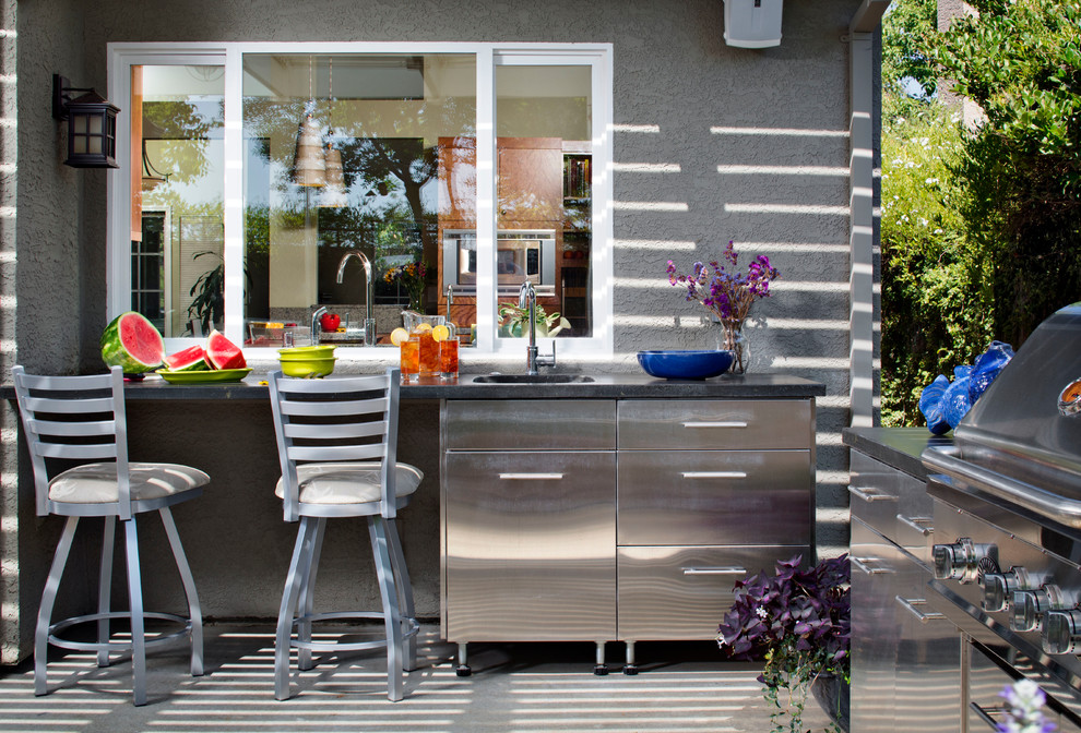 a prep area that connects two kitchens through a window is a very smart design decision - Outdoor Kitchen Designs Photos