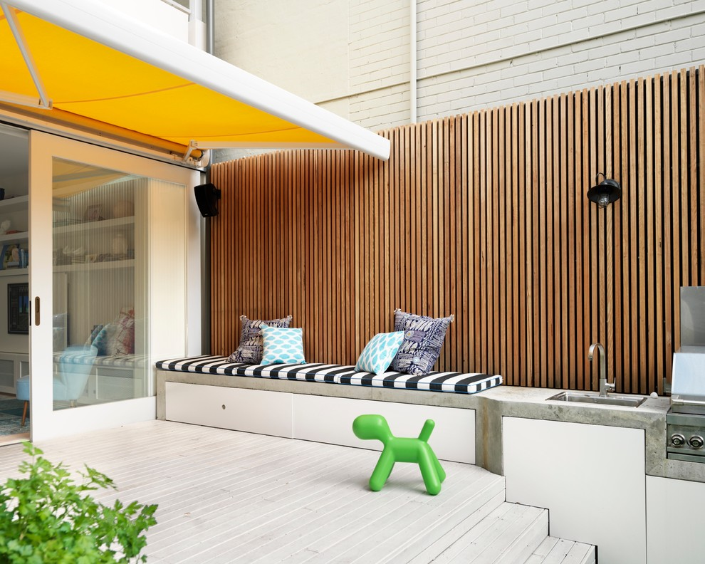 A concrete bench combined with a barbecue and a sink is an interesting space saving idea.