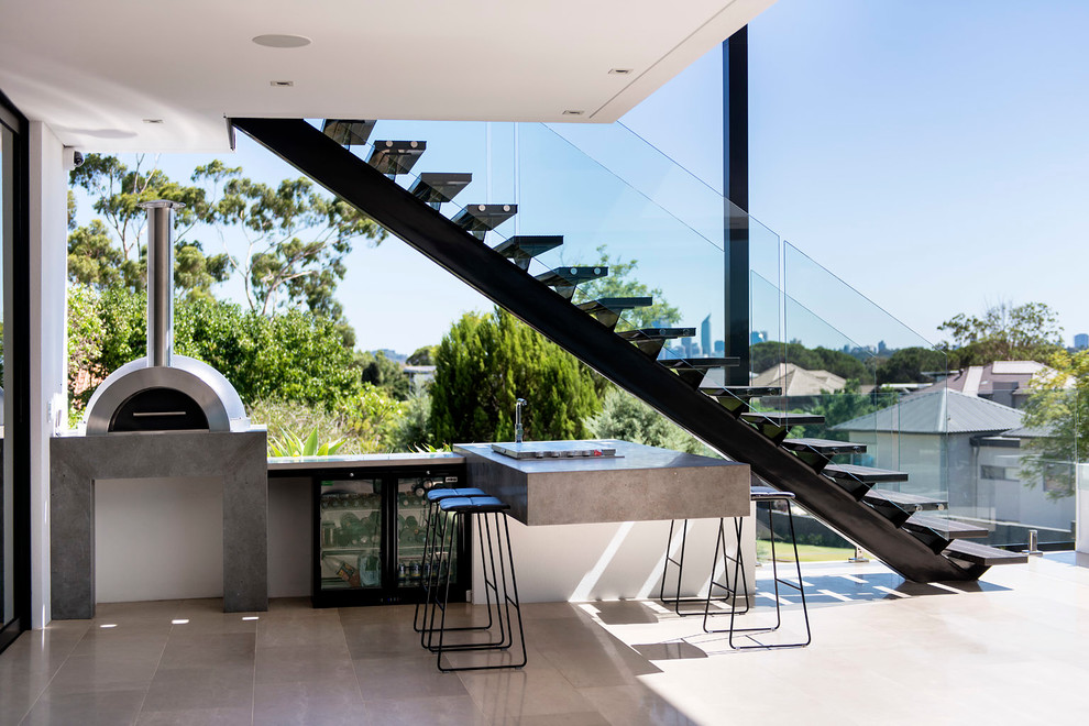 This Contemporary Entertaining Area Hides A Little Kitchen Under A Modern  Staircase.