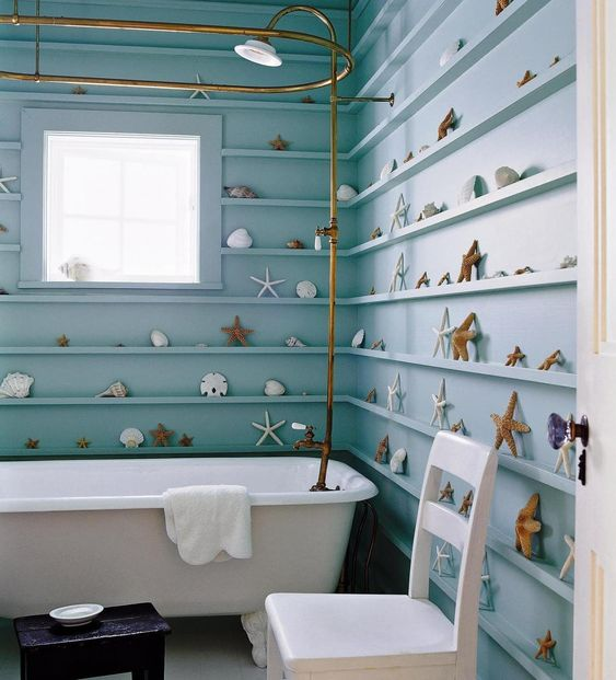 a beach-inspired bathroom with ledges for displaying starfish, seashells and other items that create a chic look