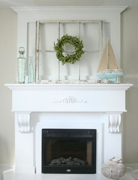 a beach mantel with a window frame, a blue boat with starfish, aqua bottles and starfish looks relaxed