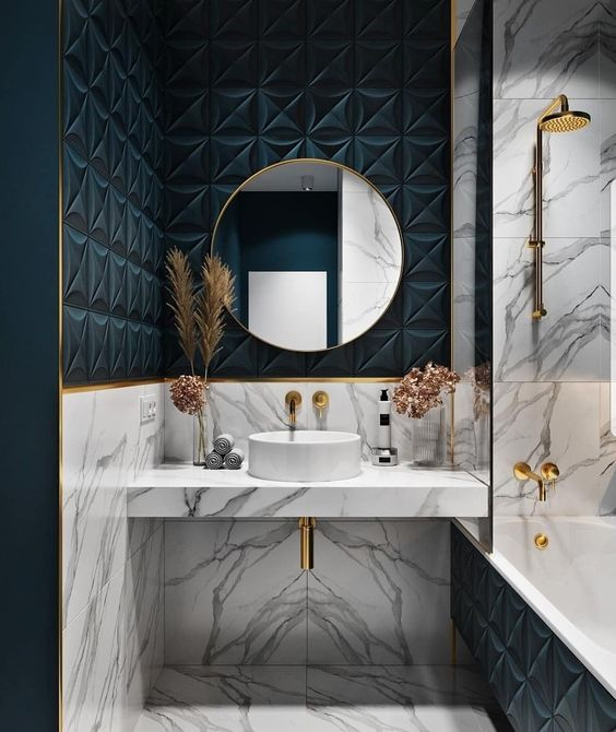 a bright bathroom with teal panels, white marble and gold hardware is a very chic and bold idea