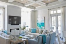 a bright beach living room with turquoise touches, light blues, creamy and white items