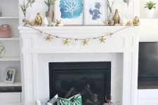 a bright beach mantel with a starfish garland, colro block vases, seaside artworks and succulents
