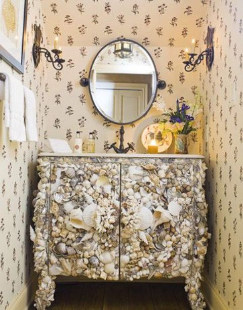 a chic powder room vanity clad with seashells is a lovely idea for a modern beach space is a gorgeous idea