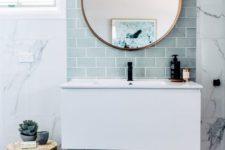 a contemporary bathroom design in blue shades
