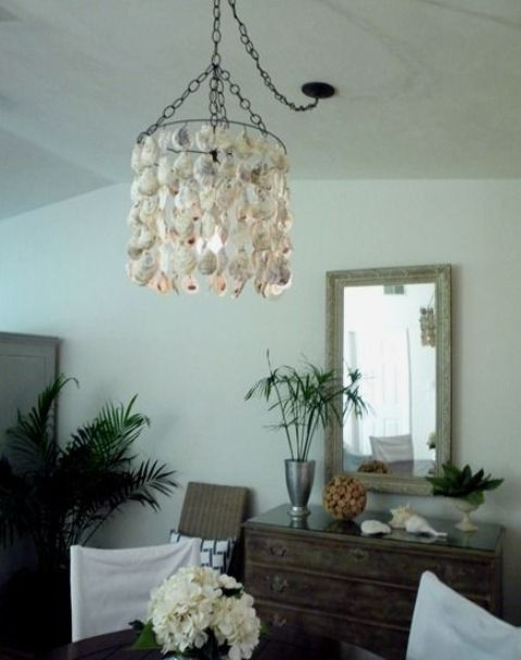 a creative seashell chandelier for a beachy boho space looks cool and chic and can be easily DIYed