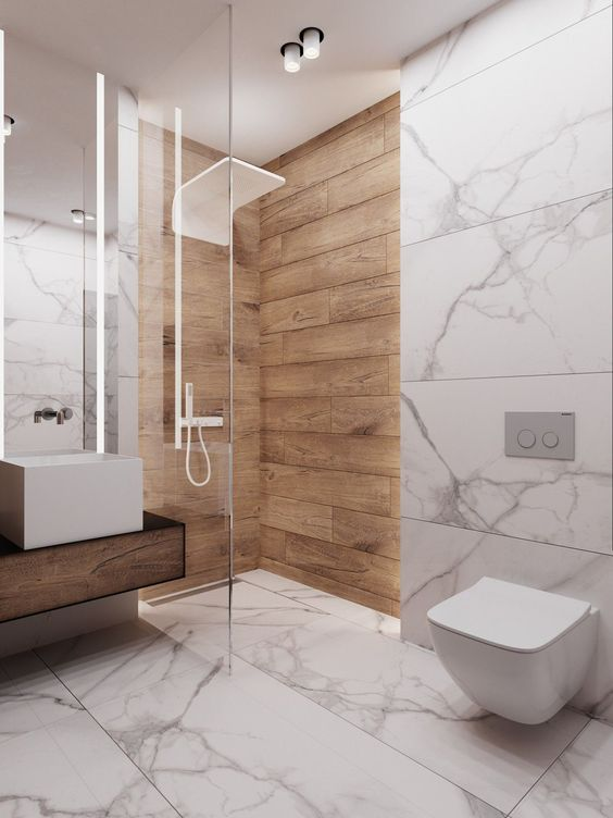 a minimalist bathroom with white marble, a floating wooden vanity and natural wooden planks in the shower