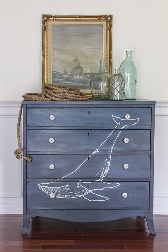 a navy dresser with a whale is a lovely idea for a nautical or coastal space, it will add color and interest