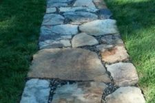 a rough stone garden path with little pebbles in between is a stylish and very simple idea