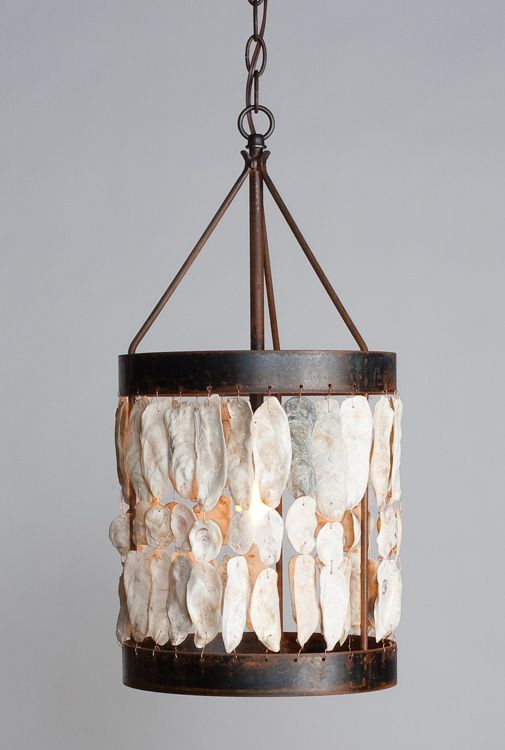 a shell drum light is a gorgeous pendant light idea for a coastal or nautical space
