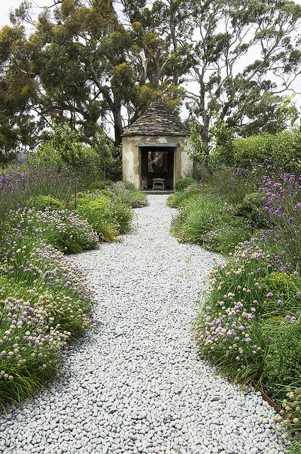 a simple and natural white pebble pathway will fit many garden styles