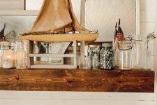 a cool summer mantel decor with a boat