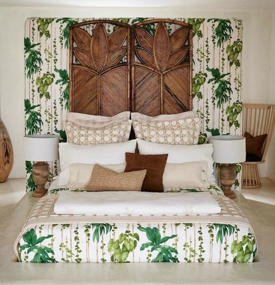 a whimsical tropical bedroom with carved wooden screens, touches of wood and rattan, tropical bedding and wooden lamps