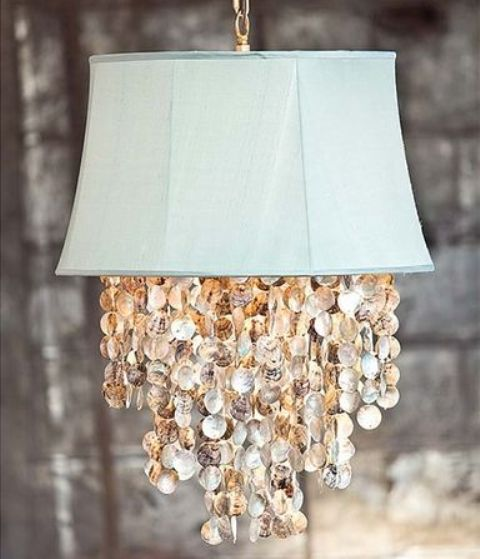 an aqua pendant lamp with seashells is a lovely idea for a coastal or seaside space, looks very unusual
