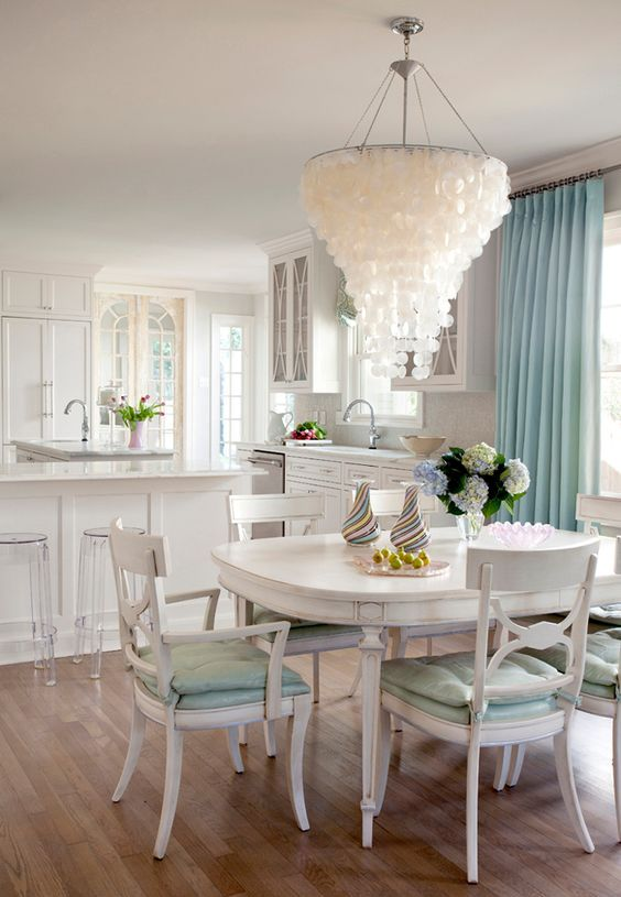 an oversized capiz shell chandelier like this one will accent any beach or coastal space at once and will make a statement