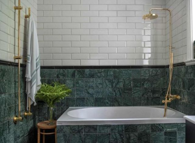 green marble tiles plus white ones and gold hardware for a bold contrasting look in the bathroom