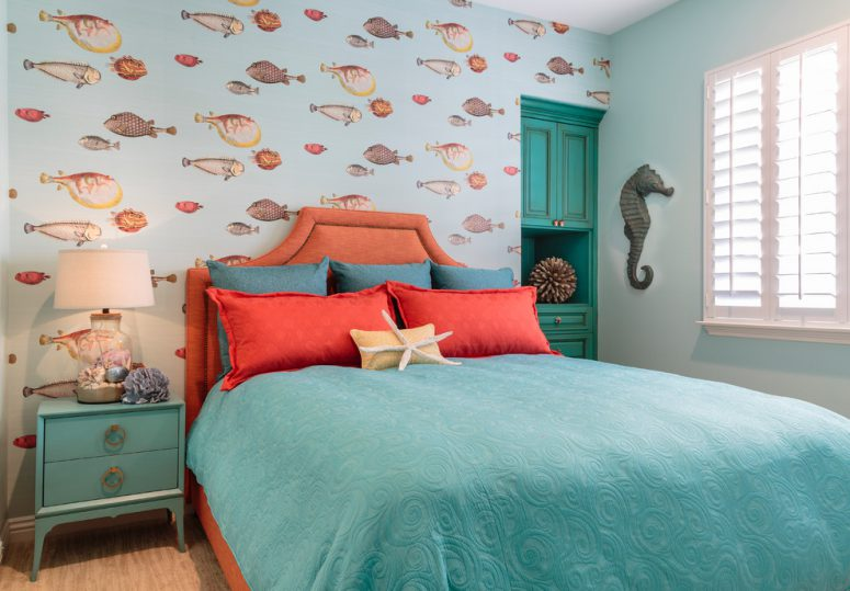 orange and turquoise color theme is perfect for a sea themed kids bedroom
