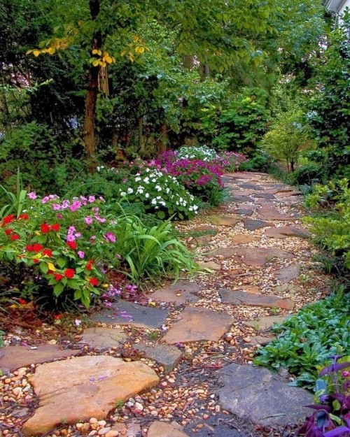 pebbles and rough stones of various shapes and looks create a very natural and relaxed path