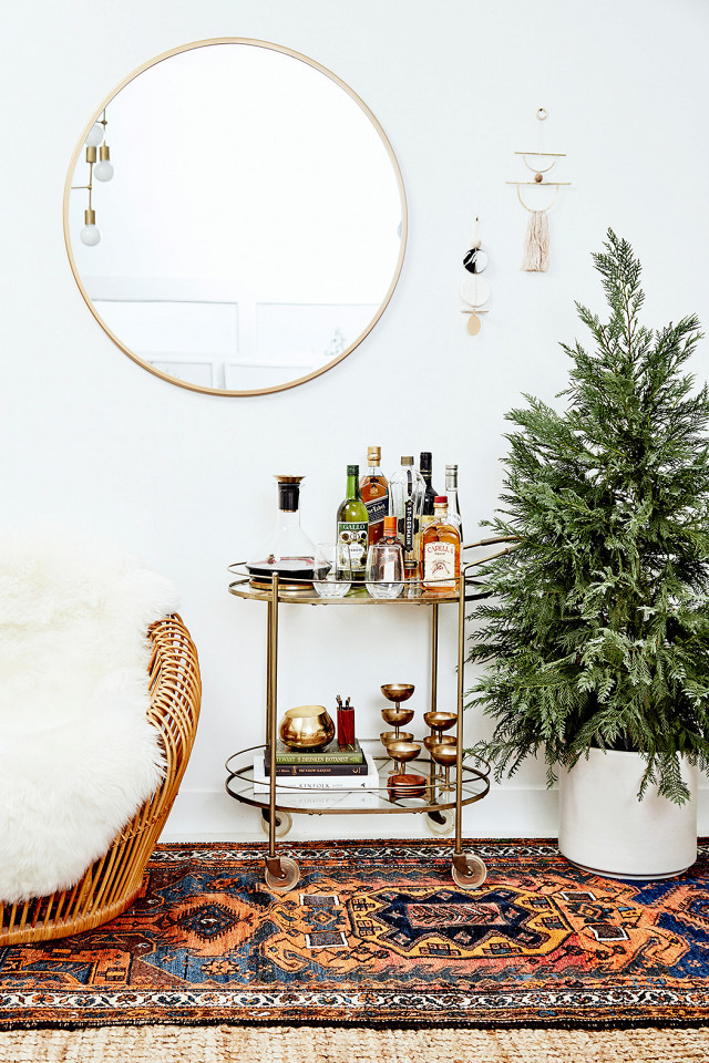 Adding a small bar cart is a great way to spruce up a bohemian living room.
