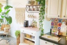 a boho chic kitchen spruced up with macrame, jute, wicker and a colorful tile backsplash